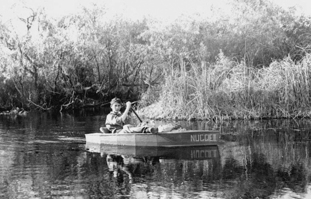 Gene as a fourteen-year-old snake catcher with his homemade canoe in the Everglades.