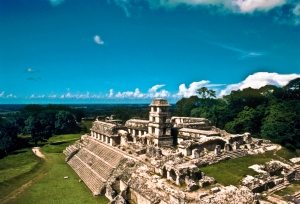 Palenque, Chiapas. The Palace is a complex raised on a broad horizontal base composed of palaces, punctuated by the unique four-story observation tower. The palaces enclose and define cloister-like, human-scaled courts.
