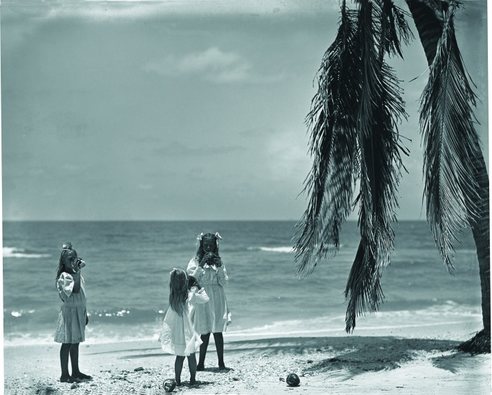 The three Olds daughters drinking from coconuts on the Marco beach. June 6, 1907; 49490. Courtesy of American Museum of Natural History