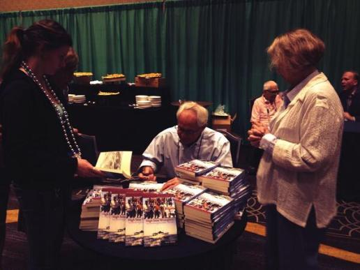 Terry Howard signs copies of High Seas Wranglers: The Lives of Atlantic Fishing Captains