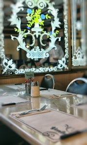 Diner tabletops balance the etched glass and help customers feel right at home.