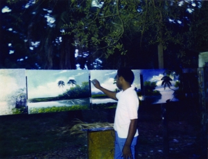 Al Black painting in backyard