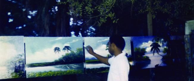 Al Black painting in backyard