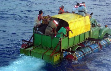 A family flees Cuba in a 1951 Chevrolet truck transformed into an amphibious motorized balsa. Photo by U.S. Coast Guard.