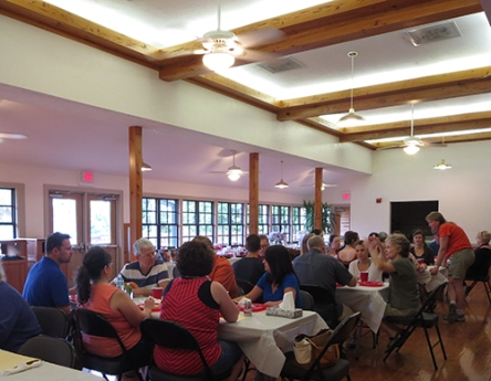 Retirement party for Lynn Werts at Lake Wauburg. The nearest table includes the IT and Business/Order Fulfillment Departments.