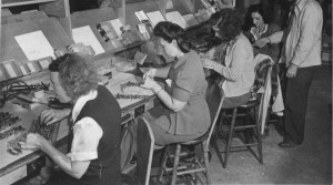 Women solder electronic parts