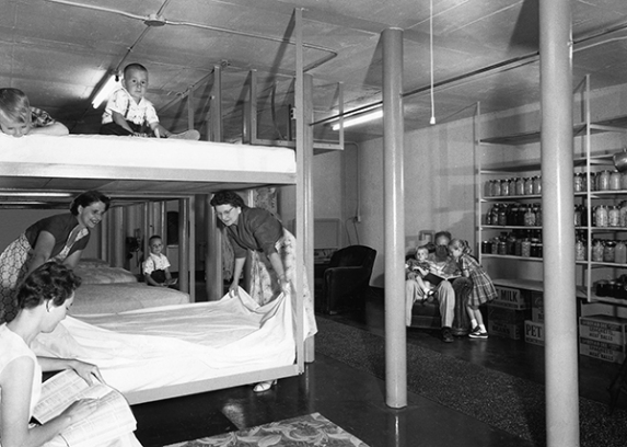 This is the Reichert family of Battle Creek, Michigan, in their $10,000 home fallout shelter in 1961. By permission of the Federal Civil Defense Administration.