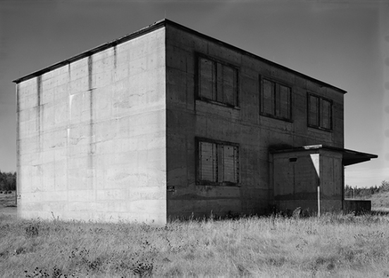 A former capsule storage building in the Loring AFB Weapons Storage Area, Limestone, Maine, in 1998. These windowless, reinforced-concrete structures were disguised with false fenestrations on the exterior to make them look like conventional buildings from a distance, but they had 10-foot-thick walls and interior bank vault doors for the highsecurity storage of nuclear weapons components. By permission of the U.S. Air Force.