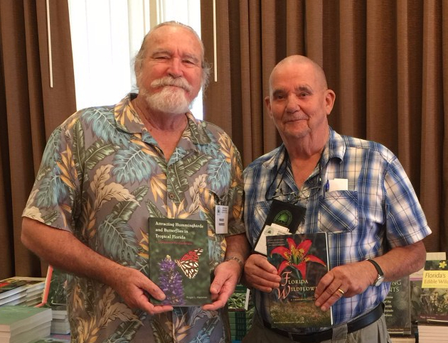 "Roger L. Hammer (left), author of ""Attracting Hummingbirds and Butterflies in Tropical Florida"" and Walter Kingsley Taylor (right), author of ""Florida Wildflowers"""