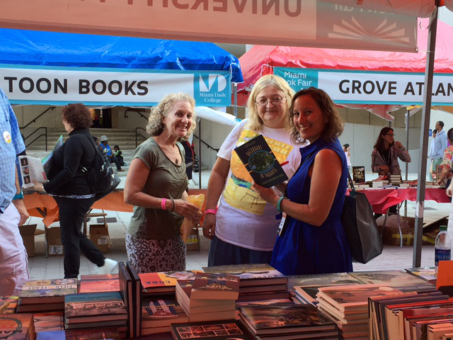 """Cathy Salustri, author of """"Backroads of Paradise,"""" signs books for attendees."""